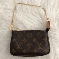 2b57a89856da BNIB Louis Vuitton Mini Pochette Accessoires Mono Brand new in box.  Includes dust bag and original tags.