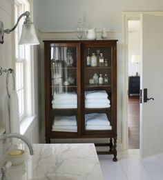 Using Vintage Furniture in your Bathrooms. It is a great option for all the Bathroom Storage Needs we have. Love the Contrast between this White Bathroom and then the Deep Wood Vintage Storage Furniture Piece. - Home Design Bad Inspiration, Bathroom Inspiration, Bathroom Ideas, Bathroom Trends, Bath Ideas, Style At Home, White Houses, Beautiful Bathrooms, Timeless Bathroom