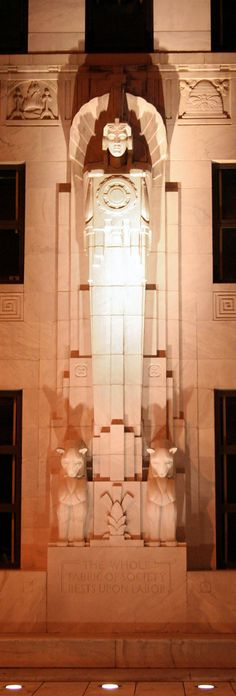 """Ohio state courthouse Art Deco figure. The base says """"The whole fabric of society rests upon labor."""""""
