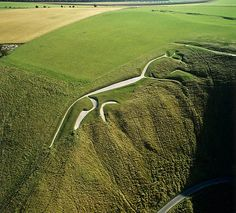 Uffington White Horse, further view: One of the oldest chalk carvings in the UK is the bronze-age Uffington White Horse. Dating back some 3,000 years it's still very visible on the slopes of White Horse Hill, Uffington. It is one of England's most famous prehistoric monuments & has inspired a number of poems and stories inc. in works by G.K. Chesterton, Rosemary Sutcliff & Terry Pratchett.