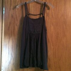 Brand new never been worn ! Flowy tank with bar back on the straps blueish gray in color perfect for summer !! This tank has never been worn and the tag is still in tact  American Eagle Outfitters Tops Tank Tops