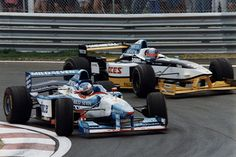 Jean Alesi scored a fine second place for Benetton Renault in the 1997 Canadian Grand Prix. Seen here forcing his way past Ukyo Katayama in the Minard Hart at the hairpin. via Flickr.