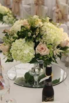 Exquisite Crystal Cake stands topped with a voluptuous display of Hydrangeas, Roses, Astrantia, Wax Flower and Astilbe