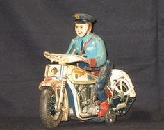 1950s Japanese Tin Lithograph Toy Highway Patrol Police Motorcycle Battery Operated. $159.00, via Etsy.