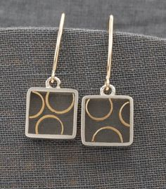 "Carla Pennie McBride: , Sterling silver and resin earrings with goldfill wire design. Approx a 3/16"" long."