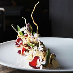 Jordan Kahn's lamb belly with salsify, sunflower seeds, hibiscus onion, hoisin sauce, star anise & pink lady apple.    Photo by Jen Munkvold  Hits Flops May 2011 | Menu | Hits-flops | Food Arts