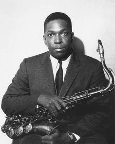 John Coltrane, young enough to be lens shy in this...