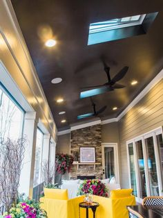 Three remote operated skylights allow natural light inside, with remote operated shades controlling the amount of light during peak sun hours. Two black smart fans operated by wall switch or smartphone feature an internal temperature sensor that increases or decreases the fan spin depending on the weather.
