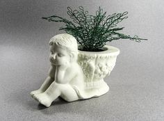 Charming Cherub with green wire plant.        $15.00