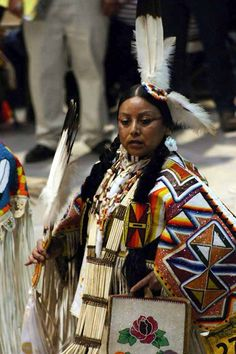 How gorgeous.  I do know that the Indigenous of North America do not wear this dress every day  :)  I would love to learn more about their culture and the meaning behind their dress.  Just beautiful