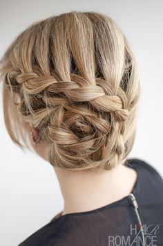 French plait curled round to make shape of a rose