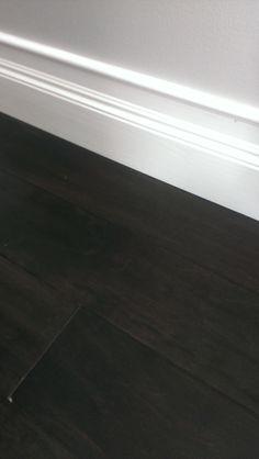 dark hardwood flooring, high baseboards