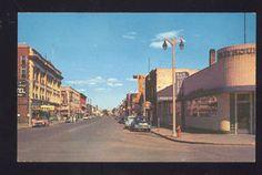 1950's CARS BRAINERD MINNESOTA STORES DOWNTOWN STREET SCENE AUTOS POSTCARD