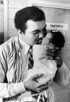 Original caption: Miami Beach, Florida: Heavyweight champ Muhammad Ali became a father for the sixth time with the birth of his fifth daughter, Laila. Ali's wife, Veronica, gave birth to the baby at am at Mount Sinai Hospital. Laila Ali, Float Like A Butterfly, Becoming A Father, Black Families, Fathers Love, Sports Figures, My Black Is Beautiful, Muhammad Ali, Family Affair
