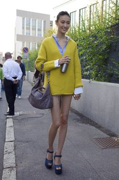 she makes me want to buy a yellow sweater and leg extensions.
