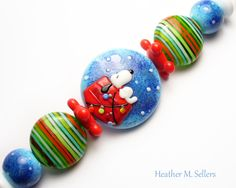 Lampwork glass beads by Heather Sellers Art Glass. #snoopy #Christmas #glass #heathersellers