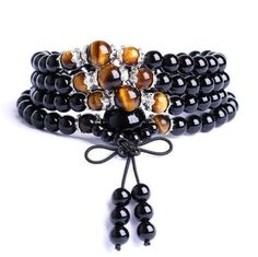Our Natural Black Obsidian Mala! Black Obsidian Stone is a powerful psychic cleanser, and is a strong psychic protection stone. It will shield you against negativity, and the energy of these stones may stimulate the gift of prophecy. This black stone is excellent for releasing disharmony that has built up in your day to day life and during work on yourself, including resentment of others, fear and anger.