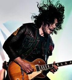 Ray Toro, best guitarist in the world. like his hair. if you don't, gerard will come to your house and suck your blood.