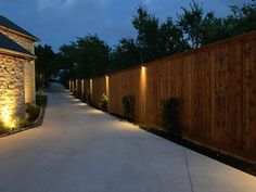Downlights along this long fence line installed by - also uplights along exterior house walls and eave lighting by Dallas Landscape Lighting Back Garden Landscaping, Backyard Fences, Modern Landscaping, Landscaping Ideas, Fence Lighting, Backyard Lighting, Landscape Lighting, Lighting Design, Exterior House Lights