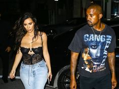 Kim Kardashian Photos Photos - Reality star and busy mom Kim Kardashian is spotted leaving her hotel in Miami, Florida with her husband Kanye West, Scott Disick, Kourtney Kardashian, Khloe Kardashian and Jonathan Cheban on September 15, 2016. Kim was rocking a very revealing black top paired with blue jeans during the outing. The group headed into a building where Kourtney was accompanied by a man. - The Kardashian Family And Friends Out In Florida