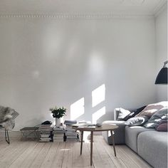 beautiful modern loft design. repurposed hardwood. exposed. wood. reclaimed. vintage. green urban living. home renovation inspiration idea. white. monochrome. neutral. simple. bright. airy. open concept.