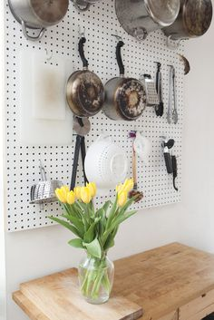 10 Ways To Upgrade Your Small Space For Free #refinery29 http://www.refinery29.com/flipping-the-block-hgtv#slide3 Turn everyday items into art — and still use them. Not only is this whole table a cutting board (genius), but arranging the pots and pans on the peg board above actually makes them ornamental. Turning necessities into decor is a free way to upgrade any room and a space-saver to boot.