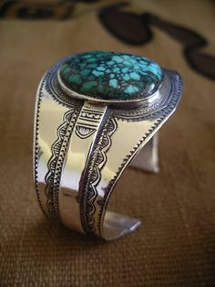 Tuareg (African) silverwork combined with Chinese spiderweb turquoise.