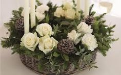 classic design white roses and greens foliage and candles