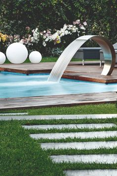 beautiful modern pool..love the faucet style water fall!! Everyone will want to come over to your Ultra Modern Pool...simply the best!