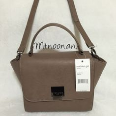 """Madden Girl Smoke Trapeze Satchel Crossbody Purse NEW WITH TAGS Authentic Madden Girl Trapeze Satchel with Removable Strap  DETAILS • Width: 12"""" across top / 9"""" across bottom • Height: 8"""" • Depth: 4"""" • 52"""" removable/adjustable strap • 3.5"""" handle drop • Interior: 1 zipper compartment & 2 slip pockets • Gunmetal tone hardware • MSRP $72.00  ❌ NO TRADES  FOLLOW ME ON INSTAGRAM @MARIANNOONAN Madden Girl Bags Satchels"""