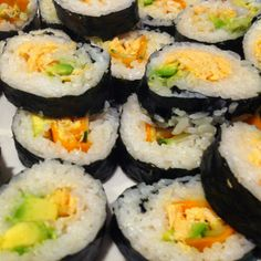 Sushi with salmon, avocado, cucumber and carrot.