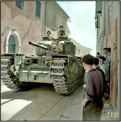 A British Army Churchill IV (NA tank of 'A' Squadron, 'The North Irish Horse' attached to the Tank Brigade passing through Via XX Settembre, a narrow street in Montefiore Conca in Rimini, Italy on the September (© IWM NA 18530 Churchill, British Armed Forces, Sherman Tank, 11. September, Tank Destroyer, Armored Fighting Vehicle, Ww2 Tanks, Battle Tank, World Of Tanks
