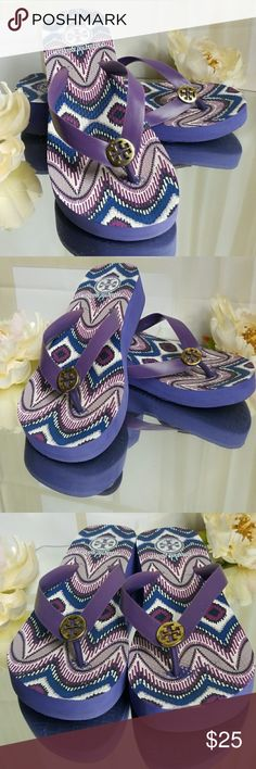 Tory Burch Purple Tribal Wedge Sandals TB Sandals only worn at the beach several times. Tory Burch*Tribal* Purple Wedge Flip flopsr Size:7 (9 1/2x 3 ¾) Flip flops can be been worn with swimwear and casual dates. These flip flops have been enjoyed and lovingly worn with fun outfits on my days at the beach. Please note that all designers have different measurements for shoe sizes. Know your shoes size and foot measurements to make your decision.  If you have Champagne taste and beer budget…