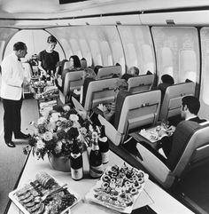The golden age of air travel, This 1970 image shows first-class passengers in a BOAC Boeing 747 jumbo jet being served lunch.