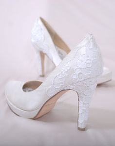 """Hey Lady Shoes  Style: Heel, Boy        See more of this collection at TheKnot.com      Save      Email      Print    White silk satin platform pump features 3 or 4"""" reembroidered heel and full Poron® padded insole with built-in arch support. Sizes 5-10"""