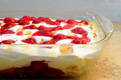 Heaven on Earth Cake...delicious layers of  angel food cake, vanilla pudding with sour cream, cherry pie filling and toasted almonds...easy to make for potlucks and parties...every bite is like heaven on earth