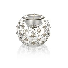 Star Of Light Tea-Light Holder.  Silver-tone stars adorn this clear glass tea-light holder, which comes complete with tea light.