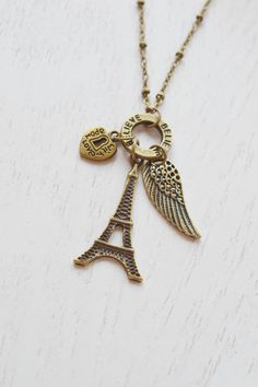 eiffel tower necklace,bridesmaid gift,wing necklace,believe,relationship necklace,romantic necklace,lariat necklace,heart jewelry,angel wing necklace,made with love,long necklace