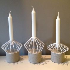 White wire and concrete/stone base candle holder by House Doctor. These look great on their own or in a cluster of all three. £16.00