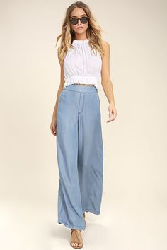 The party will come to you if you are wearing the Palazzo Blue Chambray Wide-Leg Pants! Dreamy woven chambray falls from a high, banded waist (with smocked back), to wide pant legs. Side seam pockets.