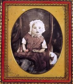 The rather awkward pose of this poor child is due to it being propped up in the chair. The facial expression doesn't help. Leaving the deceased's eyes open is a common feature of these photographs – often this would be the only photograph the family would have of their lost child and they would understandably prefer that he or she looked alive.