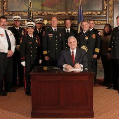 Governor Dayton with State Fire Chiefs after working together to sign legislation.
