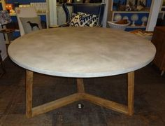 reclaimed teak dining table with concrete top, from mecox