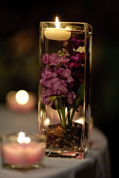 Flowers in water with floating candle