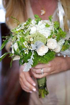 Bridesmaids carried bouquets of garden roses, hydrangea, wax flower, sedum, euphorbia, and green dianthus. Emily's bridal clutch was similar, with leftover lace from her dress woven in. #refinery29 http://www.refinery29.com/martha-stewart-weddings/11#slide-7
