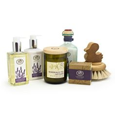 Spa Indulgences Gift Set  $100.00 Perfect for pampering, this luxurious and eco-friendly gift set includes our Lavender Spa Collection, filled with deliciously scented and organic bath salts, lotion and more, along with a Reclaimed Wine Bottle Soy Candle and our sensually soft Horsehair Duck Brush.They'll feel pampered and precious.