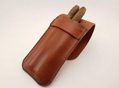 Very classy cigar case made of leather. The pattern is for sale at https://www.etsy.com/se-en/listing/538400060/pattern-leather-cigar-case-three