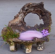 """fairy house furniture from my Etsy site made from the knot hole of a tree."""