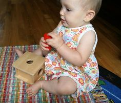 Here is a blog that has a lot of Montessori ideas for babies.  It is full of ideas you can make at home.
