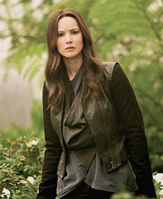 Katniss in the rose garden. Looks like she just found Snow.